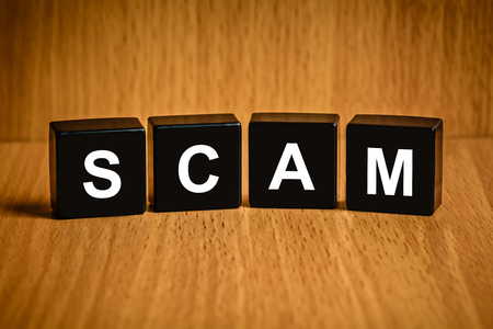 security technology: Scam, fraud text on black block, technology security concept Stock Photo