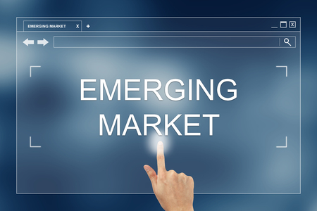 emerging market: hand press on emerging market button on webpage