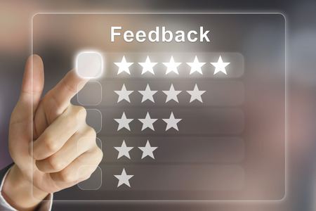 business hand clicking feedback on virtual screen interface