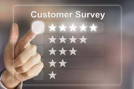 survey: business hand clicking customer survey on virtual screen interface