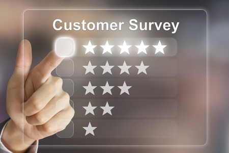 business hand clicking customer survey on virtual screen interface