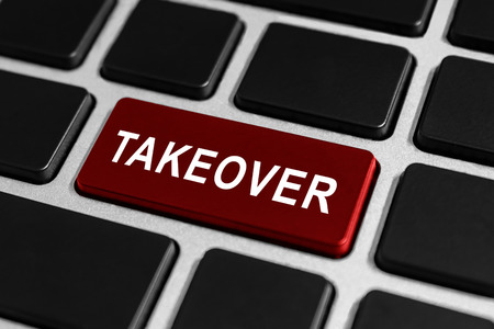 takeover: takeover red button on keyboard, business concept Stock Photo