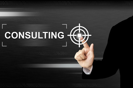 business hand clicking consulting button on a touch screen interface Stock Photo