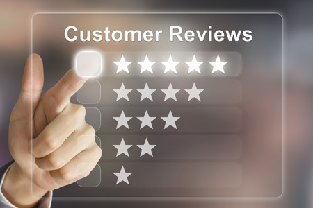 reviewing: business hand clicking customer reviews on virtual screen interface