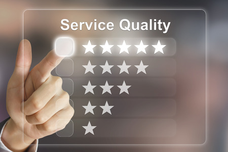 good quality: business hand clicking service quality on virtual screen interface Stock Photo