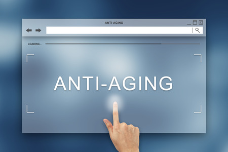 aging: hand press on anti aging button on webpage