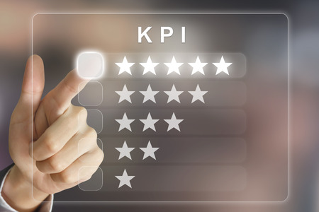 assessment system: business hand clicking KPI or Key Performance Indicator on virtual screen interface