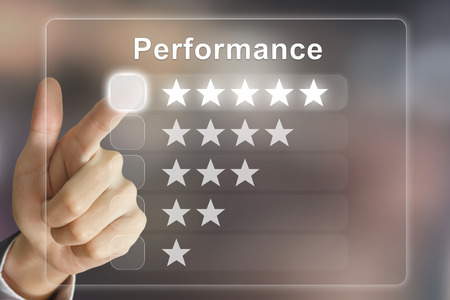 financial performance: business hand clicking performance on virtual screen interface Stock Photo