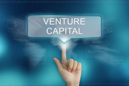 venture: hand pushing on venture capital balloon text button