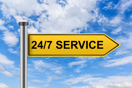 24x7: 24 hours a day, 7 days a week service words on yellow road sign on blue sky