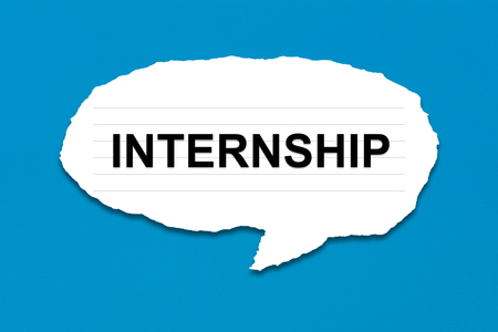 internship: internship with white paper tears on blue texture background Stock Photo