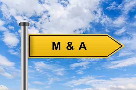 merge together: MA or Merger and acquisition words on yellow road sign on blue sky Stock Photo