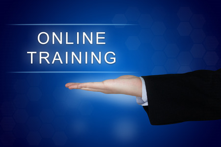 online training button with business hand on blue background