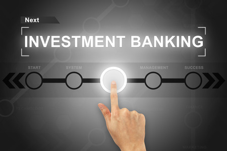 acquisitions: hand clicking investment banking button on a touch screen