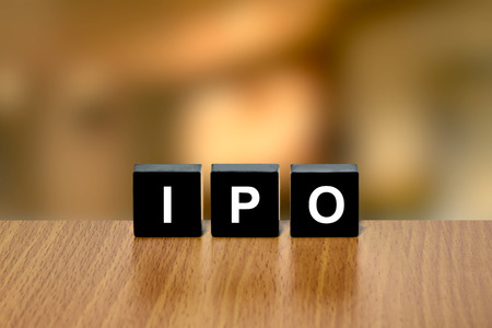 initial public offerings: IPO or Initial public offering on black block with blurred background