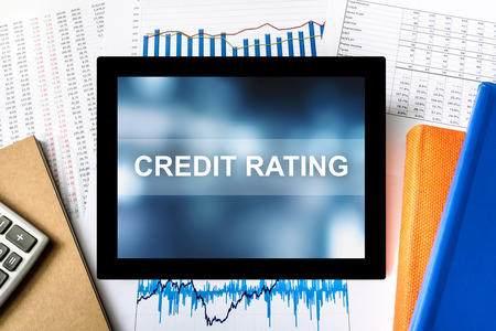 bank records: credit rating word on tablet with financial graph background