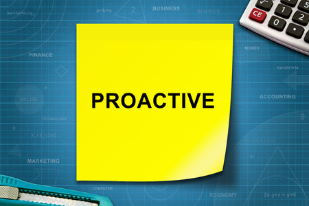 proactive: proactive text on yellow note with graph paper Stock Photo