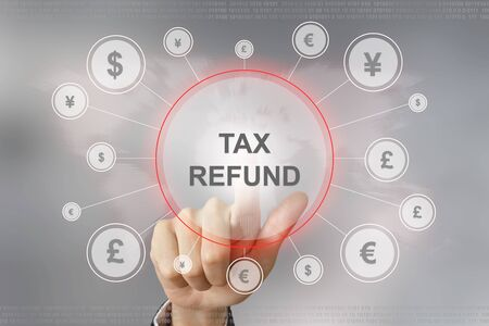 tax refund: hand pushing tax refund button with global networking concept