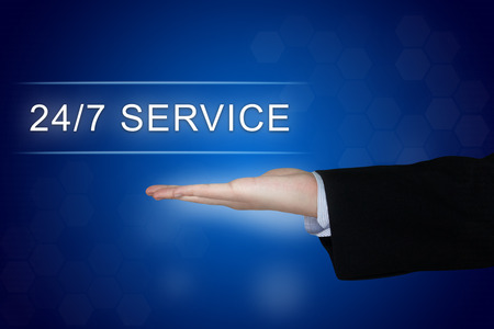 24x7: 24 hours a day, 7 days a week service button with business hand on blue background