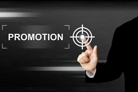 Botón promoción clic mano de negocios en una interfaz de pantalla táctil Foto de archivo - 42148344