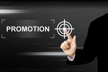 business hand clicking promotion button on a touch screen interface Archivio Fotografico