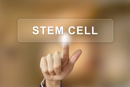 stem cell: business hand pushing stem cell button on blurred background