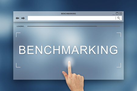 benchmarking: hand press on benchmarking button on webpage