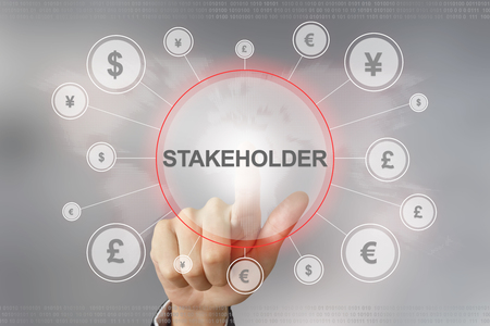 stockholder: hand pushing stakeholder button with global networking concept