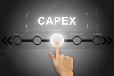 expenditure: hand clicking capex or Capital expenditure button on a touch screen