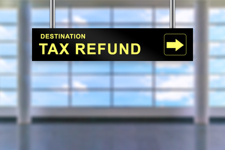 refund: tax refund word on airport sign board with blurred background