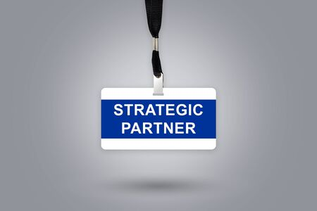 alliance: Strategic partner on badge with grey radial gradient background Stock Photo