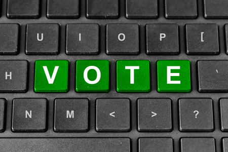 poll: Vote or poll green word on keyboard Stock Photo