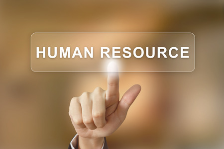 human development: business hand pushing human resource button on blurred background