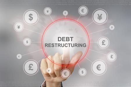 creditors: hand pushing debt restructuring button with global networking concept