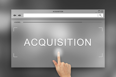 ownership and control: hand press on acquisition button on webpage Stock Photo