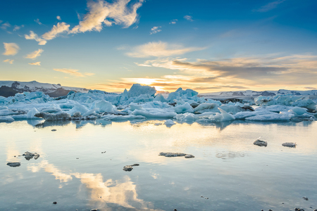 Scenic view of icebergs in Jokulsarlon glacier lagoon, Iceland, at sunset, selective focus Stock Photo