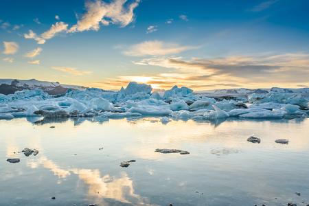Scenic view of icebergs in Jokulsarlon glacier lagoon, Iceland, at sunset, selective focus Standard-Bild