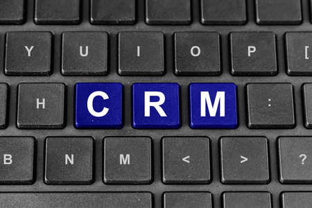 relationship strategy: CRM or Customer relationship management blue word on keyboard