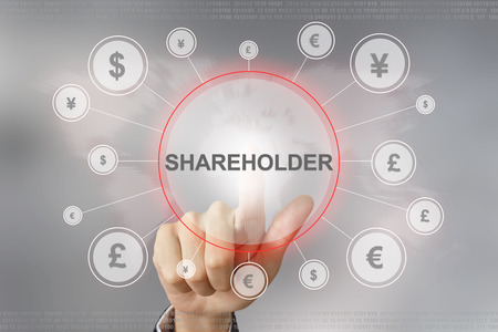 stockholder: hand pushing shareholder button with global networking concept