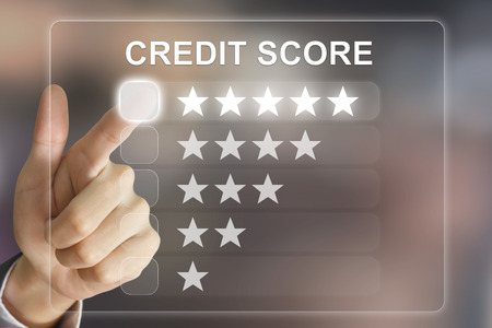 creditworthiness: business hand clicking credit score on virtual screen interface Stock Photo