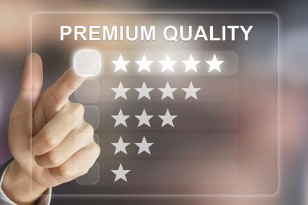 business hand clicking premium quality on virtual screen interface Archivio Fotografico