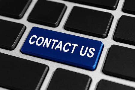 business contact: contact us button on keyboard, business concept
