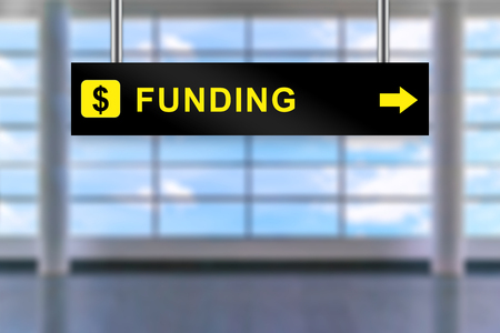 airport sign: funding word on airport sign board with blurred background