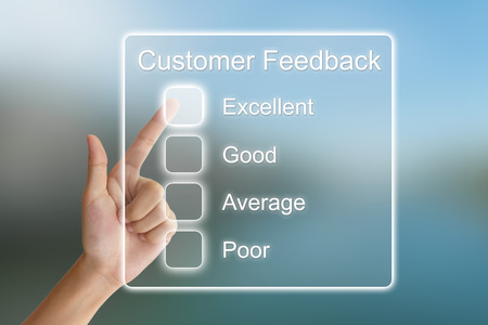 reviewing: hand clicking customer feedback on virtual screen interface