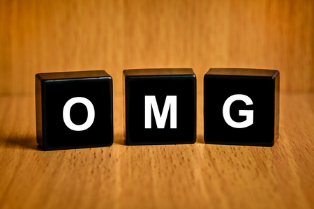 astounded: OMG or Oh My God text on black block