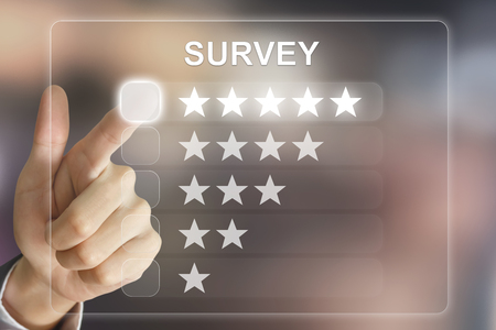 approval rate: business hand clicking survey on virtual screen interface
