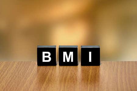 black block: �ndice de Masa Corporal IMC o en el bloque negro con fondo borroso Foto de archivo