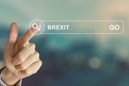 exit button: business hand clicking Brexit or British exit button on search toolbar with vintage style effect