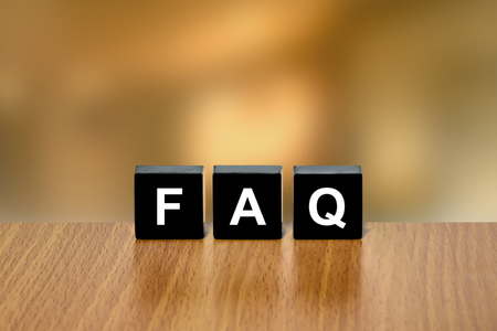 black block: FAQ or Frequently asked questions on black block with blurred background Foto de archivo