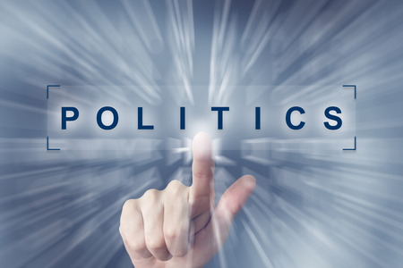 responsibility survey: hand clicking on politics button with zoom effect background Stock Photo